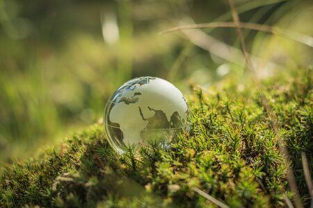 Photo pour Environment concept, glass globe in the grass - image libre de droit