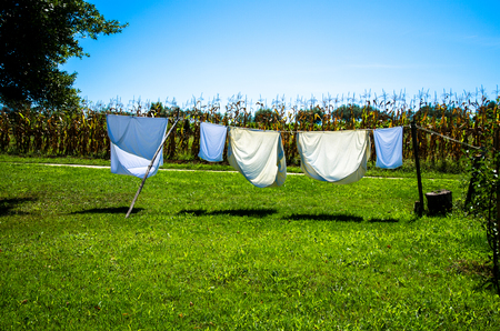 white drying clothes in washing line in the countryside
