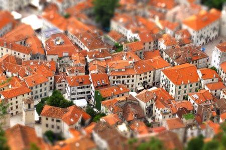 Bird eye view of buildings in Kotor old town, Montenegro. Tilt-shift Miniature Effect