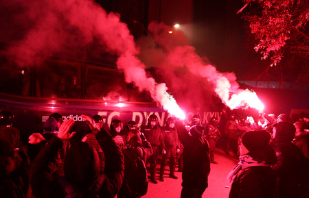 KYIV, UKRAINE - DECEMBER 9, 2015: FC Dynamo Kyiv ultras support their team on the road to NSC Olimpiyskyi stadium before UEFA Champions League game against Maccabi Tel-Aviv