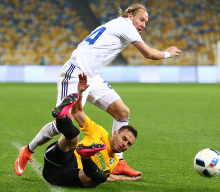 KYIV, UKRAINE - March 1, 2016: Domagoj Vida of FC Dynamo Kyiv in White fights for a ball with Yuriy Putrash of FC Oleksandria during their Ukrainian Cup quarterfinal game at NSC Olimpiyskyi stadium