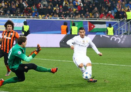 LVIV, UKRAINE - NOVEMBER 25, 2015: Cristiano Ronaldo of Real Madrid (in White) kicks the ball during UEFA Champions League game against FC Shakhtar Donetsk at Arena Lviv stadium