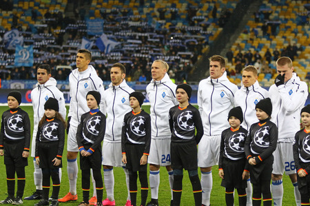 KYIV, UKRAINE - DECEMBER 6, 2016: FC Dynamo Kyiv players listen to official anthem before UEFA Champions League game against Besiktas at NSC Olimpiyskyi stadium in Kyiv, Ukraine