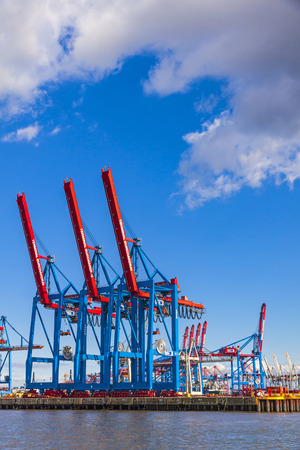 HAMBURG, GERMANY - JUNE 25, 2014: Cranes of Port of Hamburg (Hamburger Hafen) on the river Elbe, Germany. The largest port in Germany and one of the busiest ports in Europe