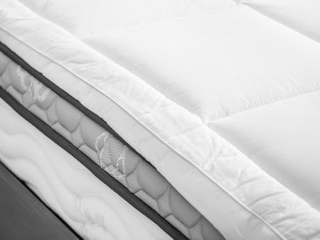 Photo pour Bed topper on bed in bedroom - image libre de droit