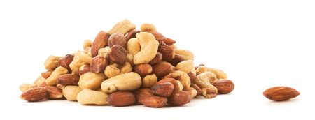 An Almond lying next to a pile of roasted mixed nuts.