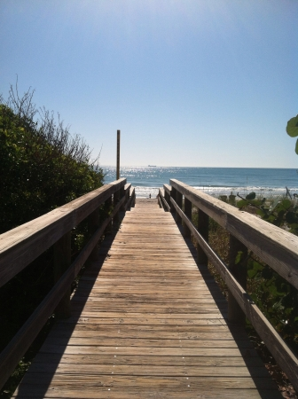 Cocoa Beach FL board walk leading from Seagull Resort to the ocean