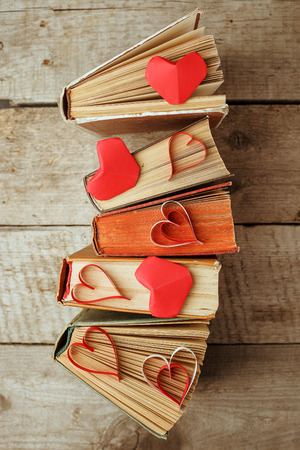 Photo pour various old books and origami paper craft red heart on vintage wooden - image libre de droit