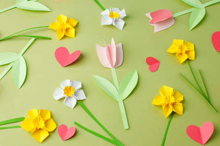 Photo for Happy Easter paper craft for kids. Paper DIY seasonal flowers and hearts pastel green background. Spring decor, reate art for children, daycare, kindergarten, flyer greeting card, holiday pattern - Royalty Free Image