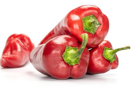 Photo for Group of four whole sweet red bell pepper isolated on white background - Royalty Free Image