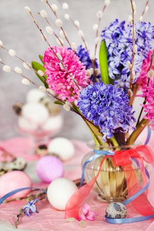 Photo for Easter eggs with beautiful hyacinths and willow bouquet on light background, spring holiday concept - Royalty Free Image