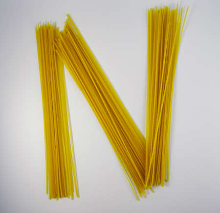 letter N of pasta isolated on white background