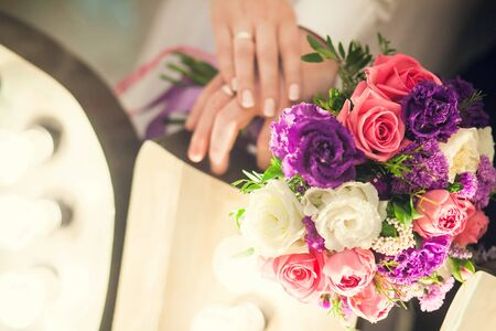 Photo for Wedding bridal bouquet on the background of the hands of the newlyweds. - Royalty Free Image