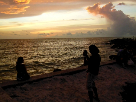Photographing girlfriend and the sunset on the Gulf of Mexico seawall