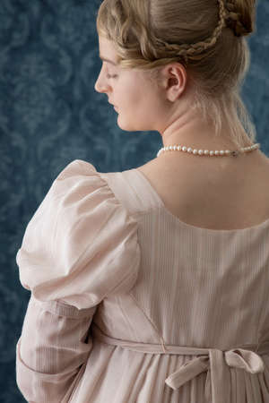 Photo for A Regency woman with blonde hair wearing a pink dress - Royalty Free Image
