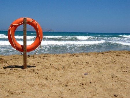 Life bouy in the empty beach of Crete, Greece