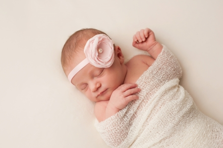 4e0dd932543 Cute newborn baby in a beige knit suit and a brown knitted cap ...