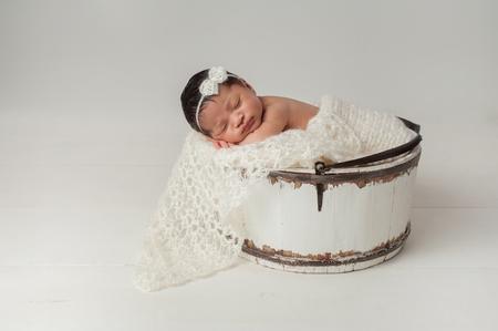 403a175685b Three week old newborn baby boy sleeping on a tiny inflatable swim ...