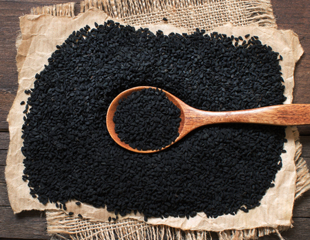 Nigella sativa or Black cumin with a spoon top view