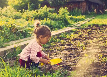 Photo pour Cute little girl having fun at countryside. Toned - image libre de droit