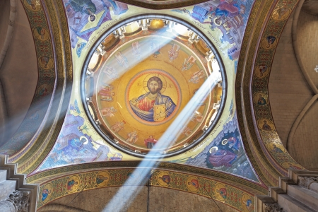 Facilities in the Holy Sepulchre.  The magnificent round arch of a ceiling is shined with two bright beams of the sun. On a ceiling image of the Christ Savior
