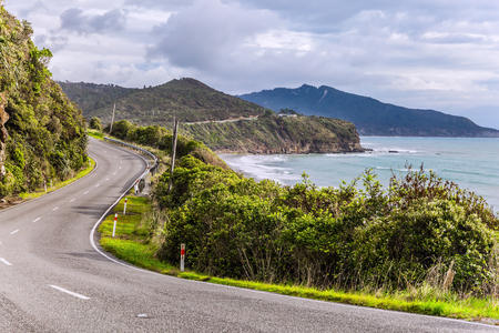 Photo pour Incredible journey to the ends of the world. Picturesque road to Pancake Rock - natural wonder of New Zealand. West Coast of the South Island. The concept of ecological, active and photo tourism - image libre de droit