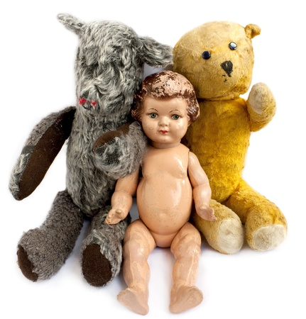 Two teddy bears and a doll on white background