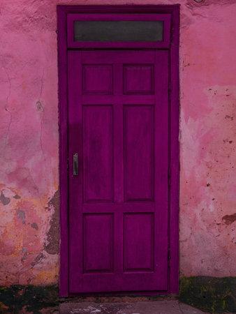 Foto de Vintage purple wooden door. Antique building exterior detail. Street photo. Retro violet wood boards. Empty abstract grunge painted texture, colorful weathered wall. - Imagen libre de derechos