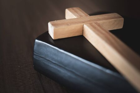 Photo for The crucifix lay on the bible. It is a blessing from God with the power and power of holiness, which brings luck and shows forgiveness with the power of religion, faith, worship. - Royalty Free Image