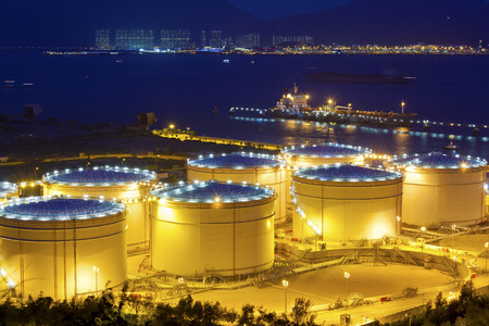 Big Industrial oil tanks in a refinery at night