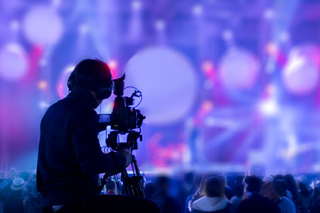 Photo for The filmmaker is recording and broadcasting live concerts on camcorders. Professional Video Recording Business - Royalty Free Image