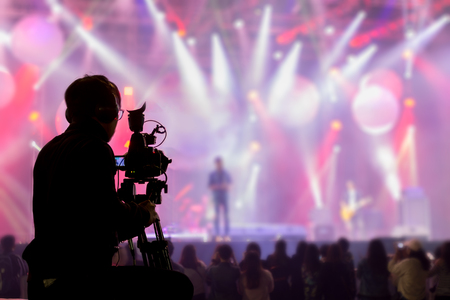 Photo pour The filmmaker is recording and broadcasting live concerts on camcorders. Professional Video Recording Business - image libre de droit