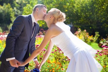 wedding couple kissing outdoor