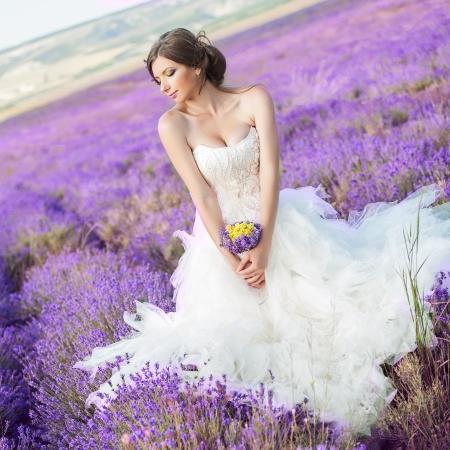 Beautiful bride posing at field of lavender