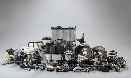 Photo pour car parts on a gray background - image libre de droit