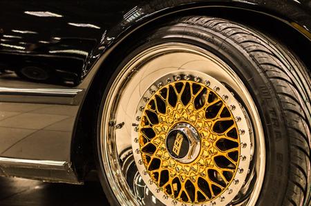 BBS logo close up on a chrome golden luxury car rims