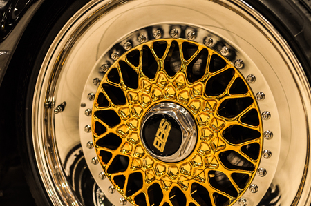 BBS logo close up on a chrome golden luxury car rims