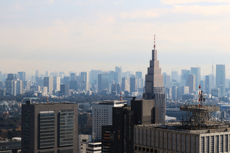 Photo pour A view of Tokyo with a cell phone radio tower and various buildings - image libre de droit