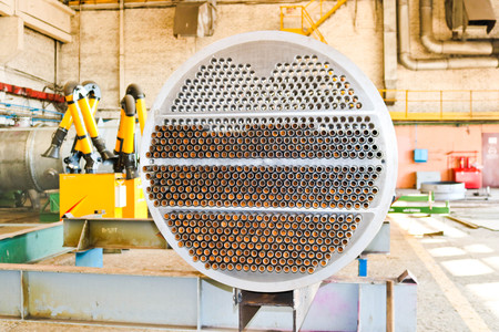 Photo pour Production of a large tube bundle for a shell-and-tube heat exchanger in an industrial production room of a shop with equipment at an oil refinery, petrochemical, chemical plant, enterprise. - image libre de droit