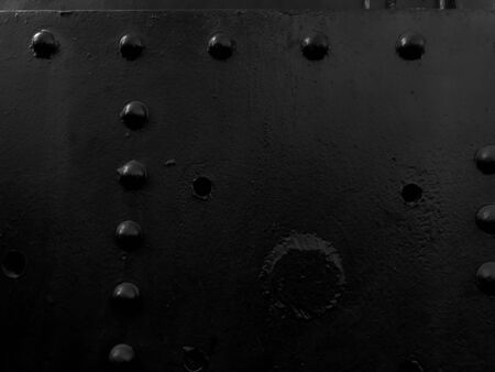 Photo pour Black iron metal rough painted strong solid industrial wall with rivet holes and bolts. Background, texture. - image libre de droit