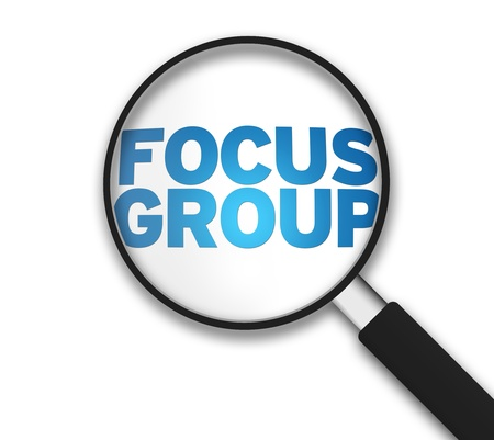 Magnifying Glass with the word Focus Group on white background.
