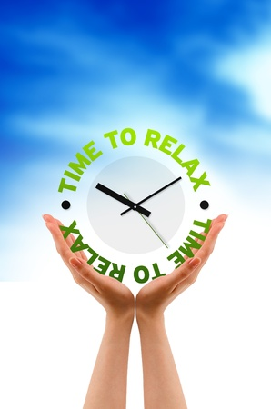 Hand holding a relax clock sign on cloud background.