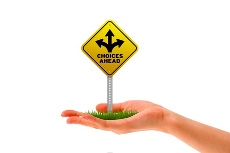 Hand holding a Choices Ahead street sign