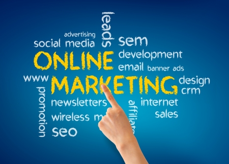Hand pointing at a Online Marketing illustration on blue background.