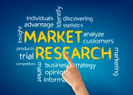 Foto de Hand pointing at a Market Research illustration on blue background. - Imagen libre de derechos