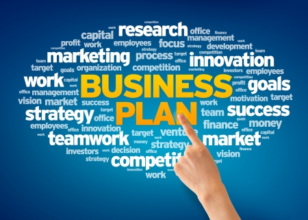 Hand pointing at a Business Plan Word Cloud on blue background.