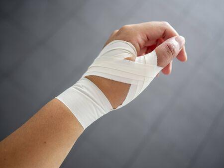 Foto de Thumb tape job for a thumb sprain - Imagen libre de derechos