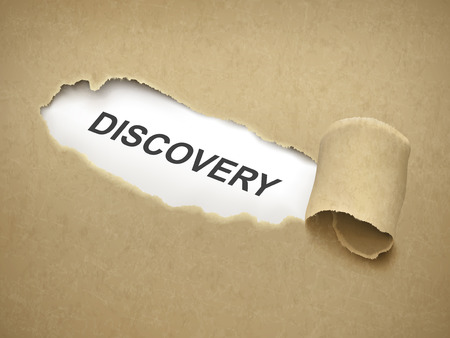 the word discovery behind brown torn paper