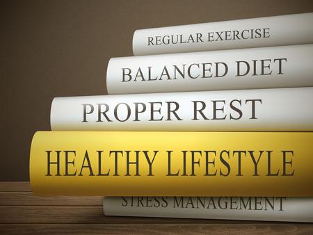 Foto de book title of healthy lifestyle isolated on a wooden table over dark background - Imagen libre de derechos