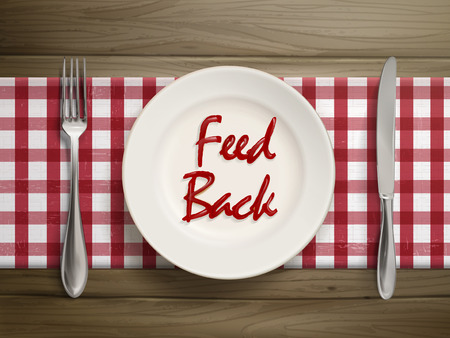 top view of feedback word written by ketchup on a plate over wooden table